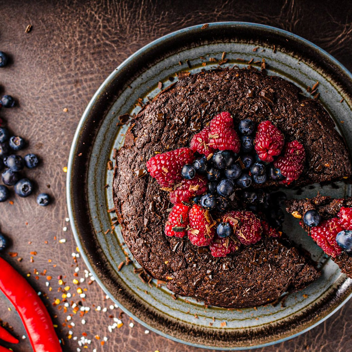 Chocolate brownie cake with chili and fresh berries