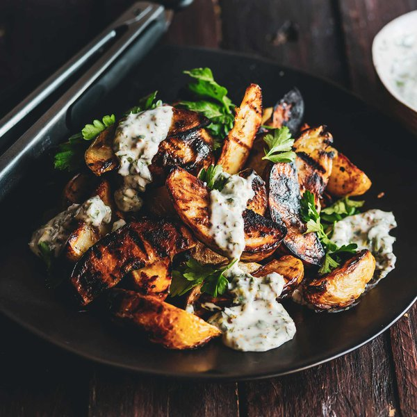 Garlic grilled potato wedges with herby sauce
