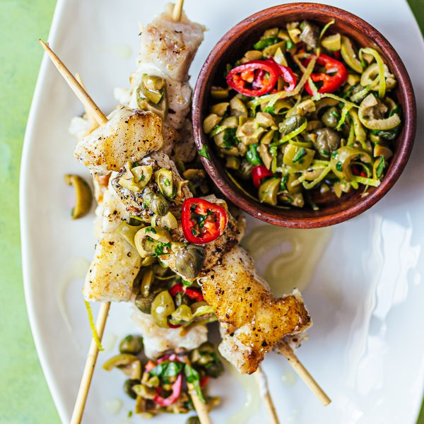 Grilled fish skewers with olive, basil and caper salsa