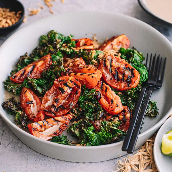 Tomato salad with crispy kale and anchovy dressing